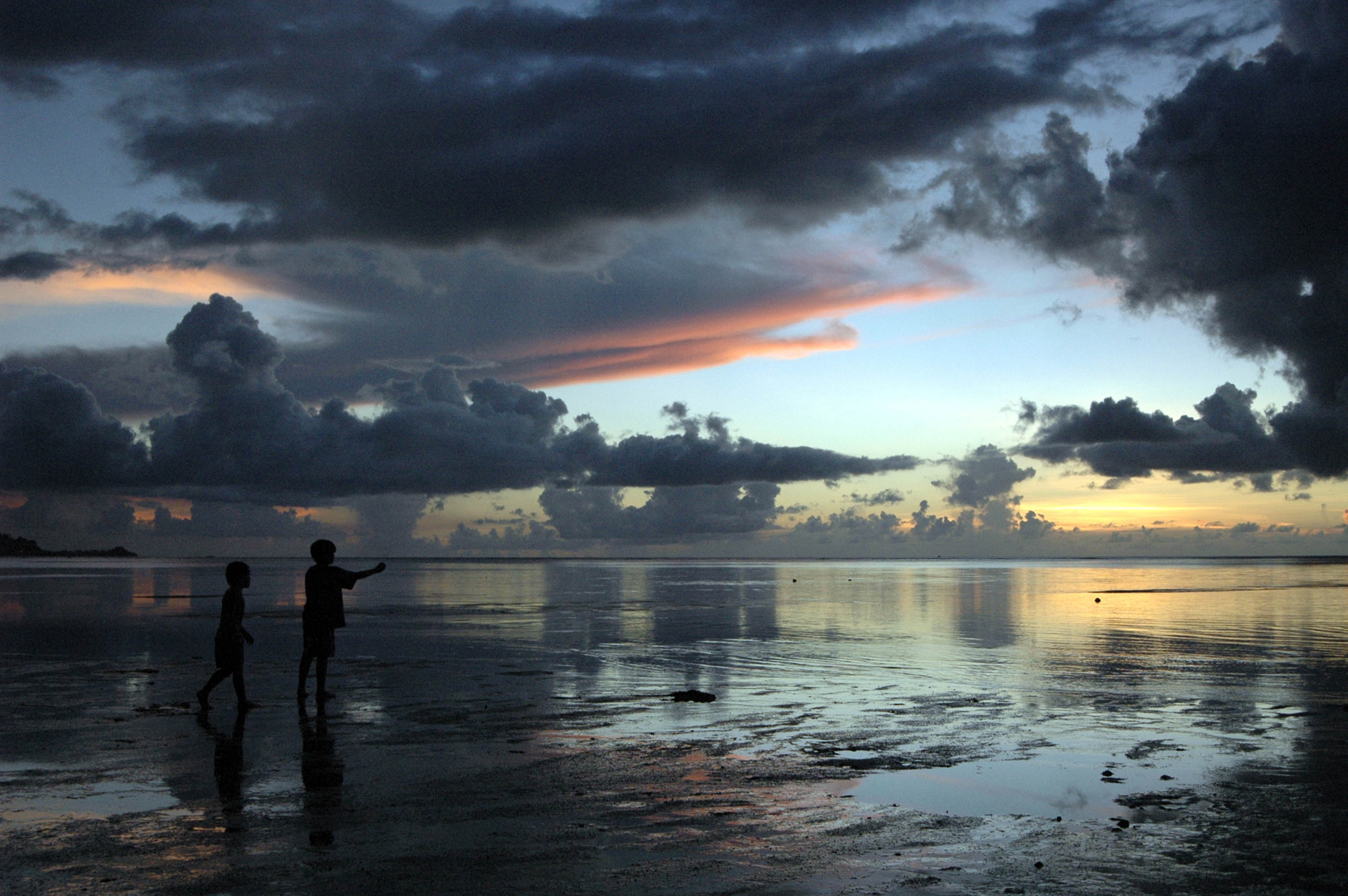 Children on beach at sunset