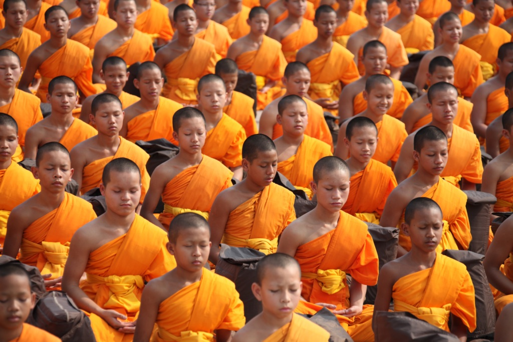 Group meditation by young Buddhists