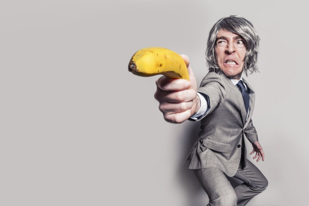 Banana Gun aimed by suited man
