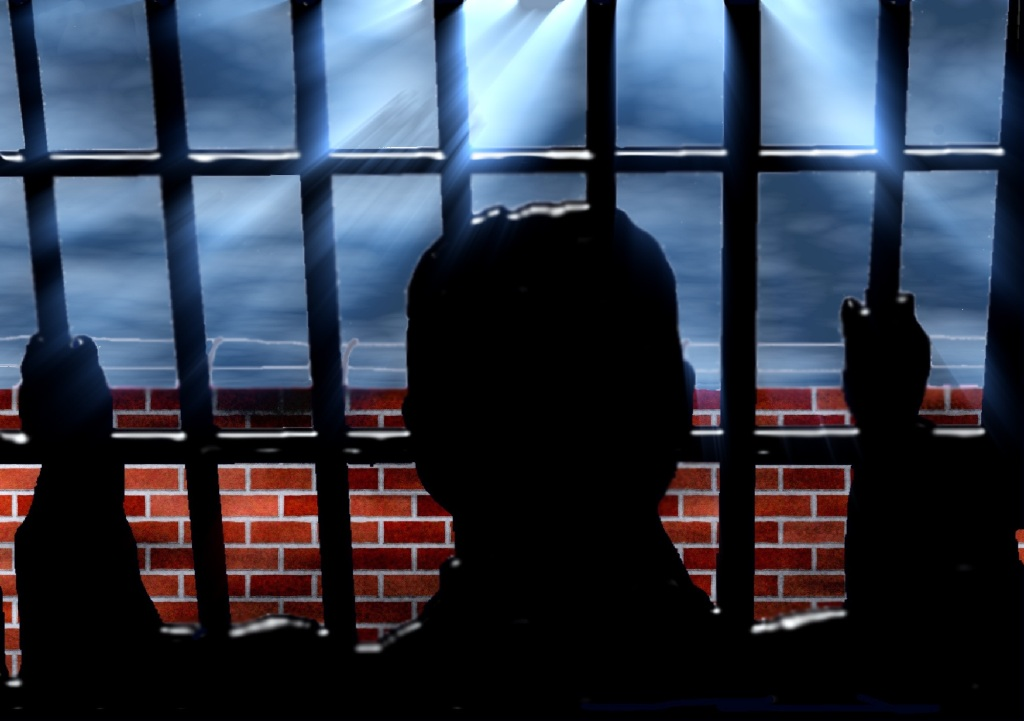 Man silhouette in prison cell