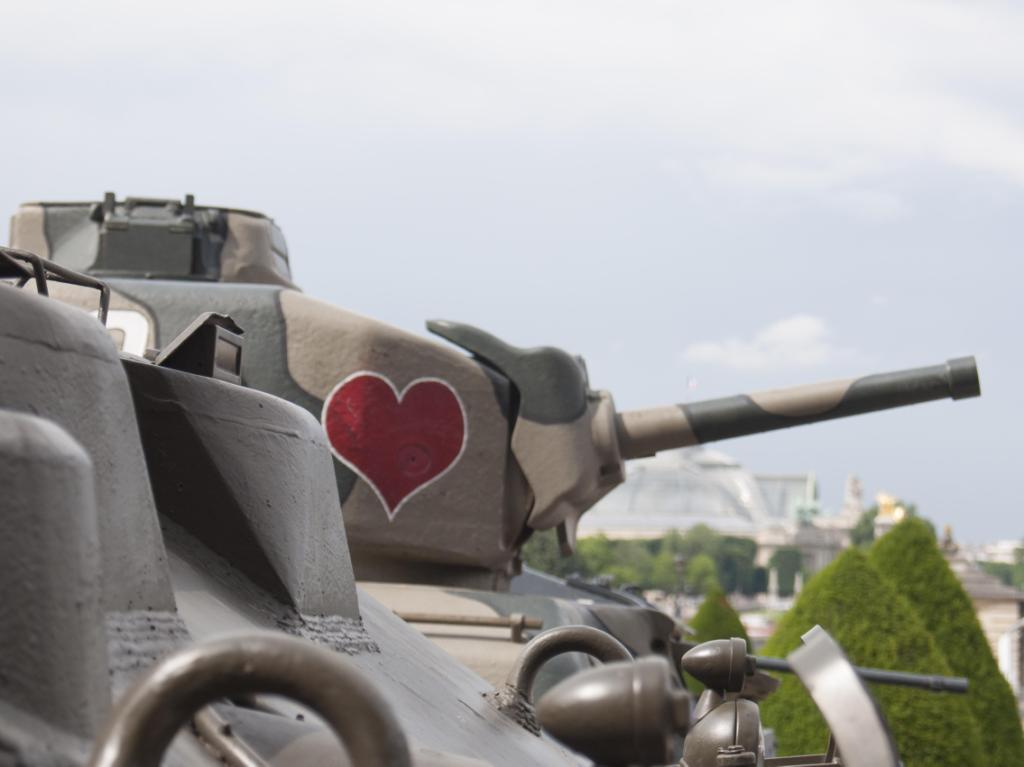 Tank with heart image on its side