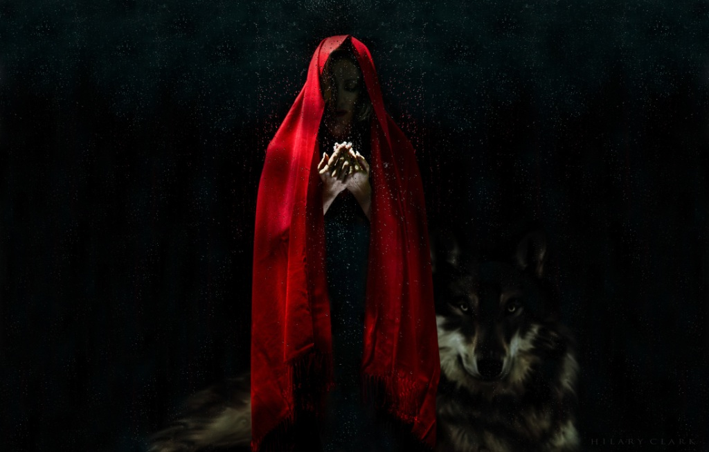 Red-cloaked woman and wolf